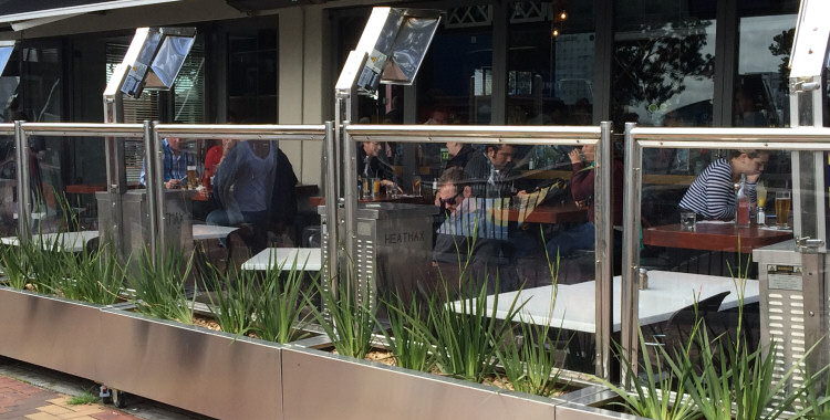 Heatmax café screens enclosing outdoor space